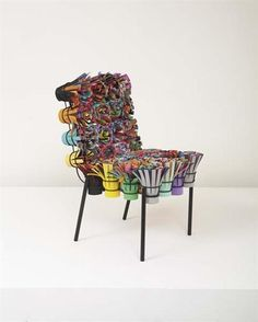 "Humberto Campana ""Sushi III"" chair, ca. 2002.  Felt, textiles, plastic, EVA, painted tubular steel. High Produced by Estudio Campana, Brazil."