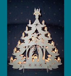 Scroll Saw Patterns :: Lighted projects :: Trees :: Nativity tree  ~ I'm sure these could also be made using construction paper, card stock or cardboard.
