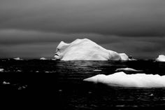 """The face of the iceberg"" . The photo was taken by the user strummingmusic during an expedition to Antarctica."