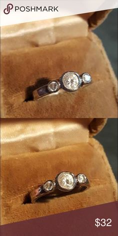 Vintage Sterling Silver CZ Ring Vintage Sterling Silver CZ Ring Size 8 marked SU marked 925 tested. Unique Round Stones in lovely Setting in fully finished under gallery. Very nice Ring!! Great Condition. Jewelry Rings
