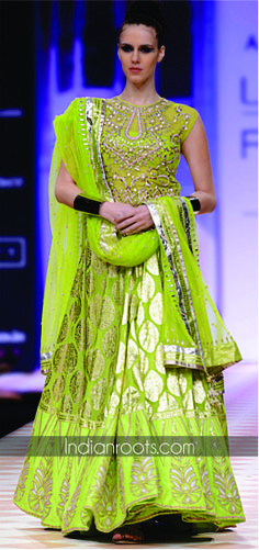 Green chanderi brocade lehenga featuring traditional gota patti embroidery by Anita Dongre on Indianroots.com
