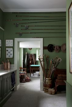 """Green mudroom with fishing rods hanging on the wall -- """"The Scottish Country House"""", author: James Knox, photographer: James Fennell, publisher: Vendome Press"""