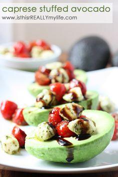 Caprese stuffed avocado- this looks amazing!