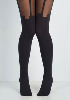 Suspends Thriller Tights. Preferred genre of movies aside, there's no denying your outfit today is inspired by your favorite heroine's most recent role! #black #modcloth