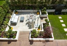 This beautiful landscaped garden from our Aura development in Cambridge offers a superb place to sit and relax in the sunshine. With a fantastic mix of greenery and patio, this is the ideal low maintenance garden.