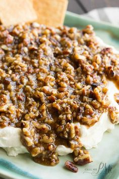 Cream cheese spread is topped with pecans praline glaze. French Quarter Pecan Cheese Spread Recipe