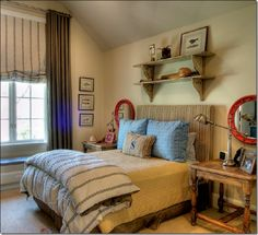Love the whole room but especially the double display shelf above the bed.