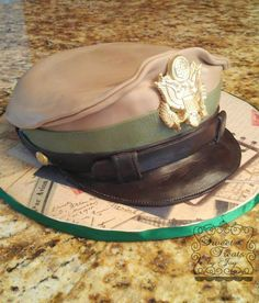 WWII Aviator Cap.  Cake is covered in fondant.  The eagle on the front is gum paste.