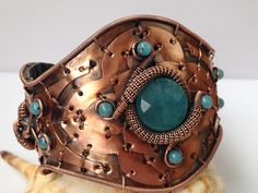 A multi-layered oxidized copper bracelet with angelite, hammered and woven by Gedő Mária