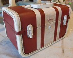 """Absolutely lovely vintage train case by Taperlite that has been painted with Annie Sloan Chalk Paint® in Burgundy and Old White racing stripes! (VROOOM!!) The paint was sealed with Clear Wax, and antiqued with14""""x8""""x8.5"""" Stack em' up!!! :)"""