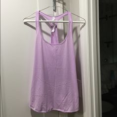 Lululemon 105 F Singlet tank Lululemon 105-F Singlet tank size 6. Worn a few times but in great condition. No stains, rips or tears. lululemon athletica Tops Tank Tops