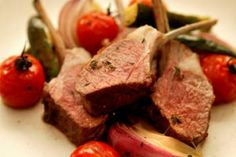 Rack of lamb with roasted tomatoes and bearnaise sauce.