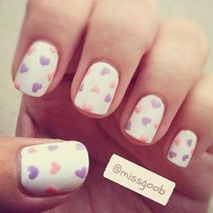 Pastel Heart Nails - Paint nails with a nice white base, then pick 2 or 3 pastel colors for hearts. Use a tooth pick or thin nail polish brush to make small hearts; alternate hearts at different angles for a more whimsical feel. Cover with a clear top coat if desired =]