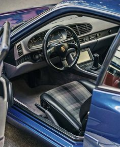 Porsche 944 with custom A/V system, Club Sport steering wheel and tartan cloth seat inserts.