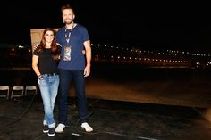 Danica Patrick driver of the GoDaddy Chevrolet and television personality Joel McHale pose for a photo opportunity prior to the taping of E's 'The...