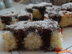 Čokoládovo-kokosové řezy 250 g Héry, 200 g čokolády na vaření, 1 hrnek cukru, 1,5 hrnku hladné mouky, hrnek mléka, 2 vejce, přášek do pečiva, vanilkový cukr.Kokosová náplň: 250 g kokosu, 1 Salko, vejce.