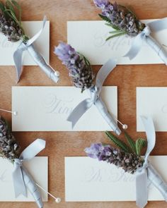 All the groomsmen will look handsome with their purple floral boutonnieres.