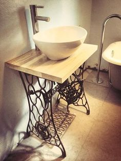 This is my newly competed Vintage Basin stand with egg shaped basin. The top is made from ash wood and was custom cut to fit the modern tap and basin. This vintage bathroom was perfect for my small bathroom idea - it's now a little space with plenty of impact :) It was fun and easy to make! The plumbing is hidden somewhat by the singer sewing machine stand, so it all blends in rather nicely!