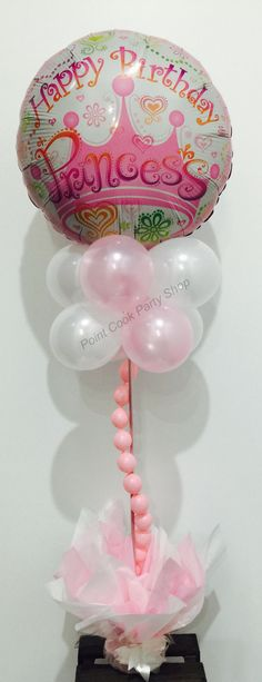 Princess theme balloon table decoration. Light pink and white pearl balloons.