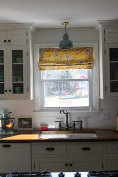 white cabinets with butcher block countertops via www.mapleleavessy...