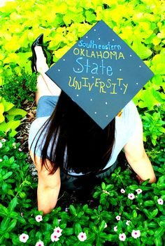 Graduation Photo Idea. Write the name of the graduate's  college on a mortarboard.