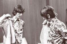 George Harrison and Ringo Starr get ready to go onstage in Detroit on August 13, 1966 by  Bob Bonis.