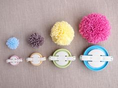 Make your own Pom Pom garland using Clover's superb Pom Pom makers.