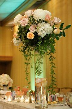 Cylinder vase floral centerpiece.