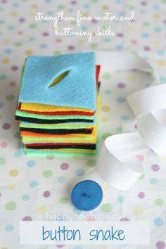 The Button Snake - as an interesting new take on the Dressing Frames, sew a colorful button to a long piece of fabric ribbon and pair it with felt shapes that have cut button holes. Children work on buttoning skills, fine motor control, threading, and can work with color and shape sorting as well!