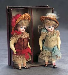 Two French Bisque Miniature Dolls in Original Costumes and Box