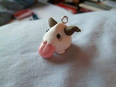 Hey, I found this really awesome Etsy listing at http://www.etsy.com/listing/155188131/league-of-legends-poro-charm