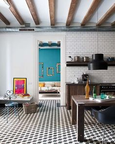 The 'tumbling block' style of this cement tile floor adds a touch of pattern to a kitchen from Door Sixteen.