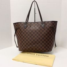 Louis Vuitton Neverfull Mm Ebene Large Damier Tote Bag. Get one of the hottest styles of the season! The Louis Vuitton Neverfull Mm Ebene Large Damier Tote Bag is a top 10 member favorite on Tradesy. Save on yours before they're sold out!