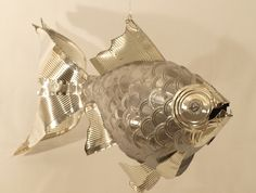 Upcycled tin cans into fish sculpture, made by Alanna Baird
