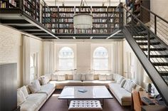 If you have crazy high ceilings, why not divide the room up with a library on top?