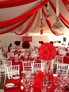 I love the tulle, and also the white chairs and red table clothes!