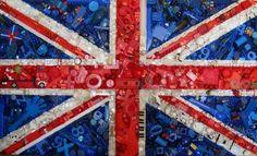 Bandera hecha con botones, recortes de revistas, cualquier cosa del color que se necesita. En clase de espanol, buenisimo para hacer la bandera de Espana, por ejemplo ;)
