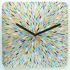Hey, I found this really awesome Etsy listing at http://www.etsy.com/listing/165999497/multicolored-orzo-burst-clock-unique