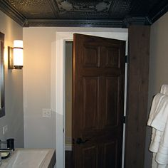 Ceilume's 'Alexander' and 'Continental' ceiling tiles were installed in this modern-style bathroom for an ulta sophisticated feel. Ceiling Panels, Ceiling Tiles, Dropped Ceiling, Colored Ceiling, Bathroom Ceilings, Tall Cabinet Storage, Photo Galleries, Modern, Basement