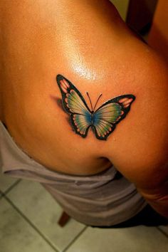 Butterfly Tattoos on Back..Need this, with purple outline, pink, green, and blue and some white colors in it..