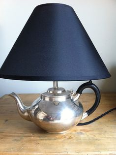 Fabulous silver plated tea pot lamp available from www.sugdenanddaughters.co.uk - a must for the vintage home.