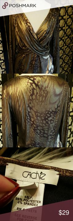 CACHE GOLD FOIL ANIMAL PRINT LONG SLEEVE BLOUSE Size large. Bust is 36 inches. Crisscross in the front. Length in the back is 24inches. Sleeve length is 25 inches long. This top is fitted and very sexy on! It is fully lined. Cache Tops Blouses