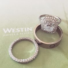 The bride wears a double halo engagement ring and wedding band by Tiffany & Co, while the groom wears Cartier.