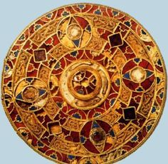 Disc brooch of Queen Arnegunde  c. 580-590 CE  Gold and  cloisonné enamel.  Merovingian  Currently in the collection of the National Museum of Antiquities in Saint-Germain-en-Laye