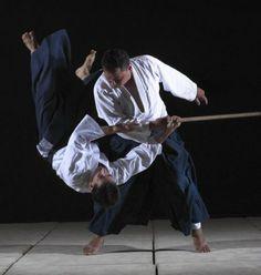 Chris Li being thrown in tachi-dori by Gerald Okada, photo by Ric Noyle