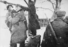 Up close and personal: German army soldiers hang Russian civilians in reprisal for partisan actions. Note the expression of the hangman in the foreground as he strains to strangle his victim already swinging from the rope. The hangman next has not yet pushed his victim off the bench.