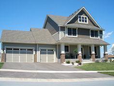 LDK Home Exterior with James Hardie siding and brick pillars.