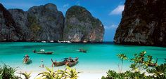 Kayaking along the stunning coastline of Koh Mae Ko, exploring 'The Beach' at beautiful Maya Bay, trekking through the jungle on an optional excursion, relaxing in a tropical paradise.