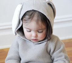 Turn your little one into the cutest little Easter bunny EVER! Hand knit in a women's cooperative in Peru. Zips in back. Also see Bambi Hoodie and Bunny Ears Blanket. - Materials: 100% Cotton - Care: