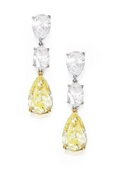 PAIR OF PLATINUM, 18 KARAT GOLD, FANCY INTENSE YELLOW DIAMOND AND DIAMOND EARRINGS Suspending two pear-shaped Fancy Intense Yellow diamonds weighing 3.05 and 2.40 carats, suspended by two pear-shaped diamonds weighing 1.02 and 1.01 carats, topped by two oval-shaped diamonds weighing .93 and .80 carat.
